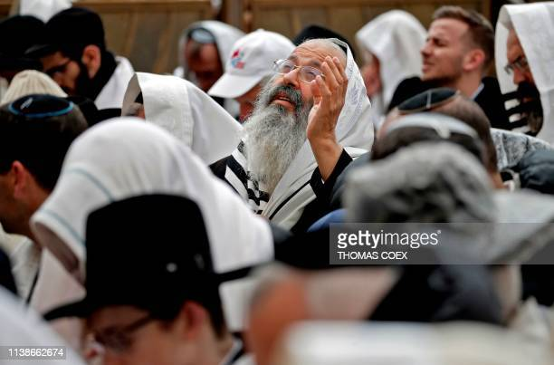 Jewish priests wearing Talit prayer shawls take part in the Cohanim prayer during the Passover holiday at the Western Wall in the Old City of...