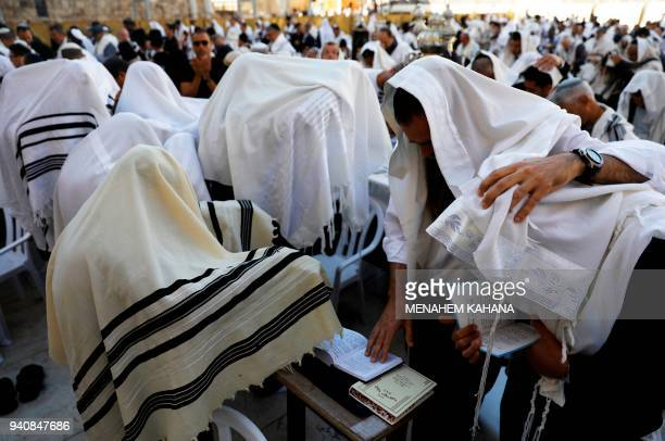 Jewish priests wearing 'Talit' take part in the Cohanim prayer during the Passover holiday at the Western Wall in the Old City of Jerusalem on April...