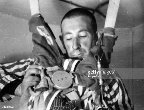 World War II 1940's Dachau Germany Human 'Guinea Pig' experiments at a Nazi Concentration Camp A Jewish prisoner hangs unconscious in the limp stage...
