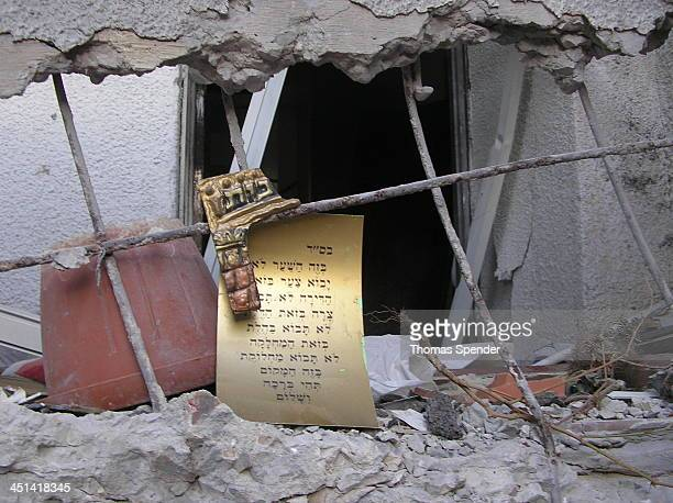 Jewish religious text lies among rubble from a katyusha rocket strike by Hezbollah in Lebanon on the northern Israeli town of Kiryat Shmona during...