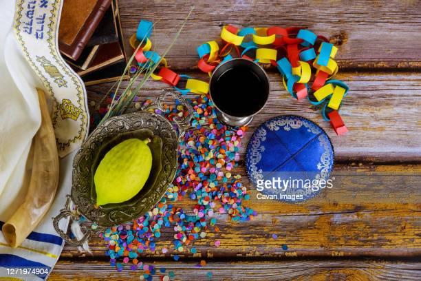 jewish ritual festival of sukkot in the jewish religious symbol over paper colorful chain garland praying book kippah tallit - 仮庵の祭り ストックフォトと画像