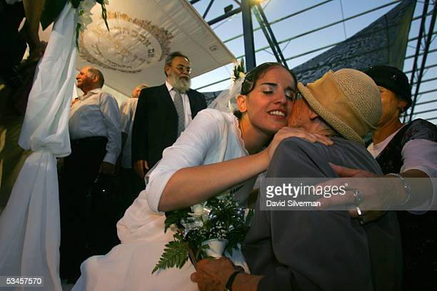 Jewish settler bride Rivka Weinstein kisses an elderly relative after her traditional religious wedding ceremony in the Faith City settler encampment...