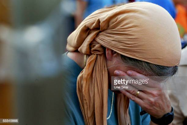 Jewish settler cries during a mass prayer aimed against the Israeli disengagement plan August 9 2005 at the settlement of Neve Dekalim in Gush Katif...