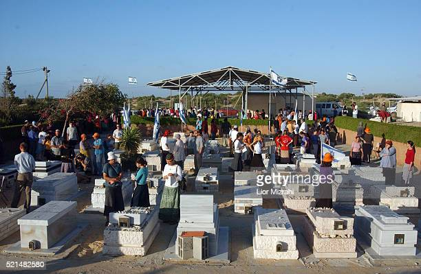 Jewish settlers a visit the Gush Katif regional cemetery near the settlement of Neve Dekalim in the Gaza Strip Sunday 07 August 2005 The graves will...