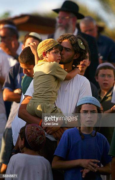 Jewish settlers attend a mass prayer aimed against the Israeli disengagement plan August 9 2005 at the settlement of Neve Dekalim in Gush Katif...
