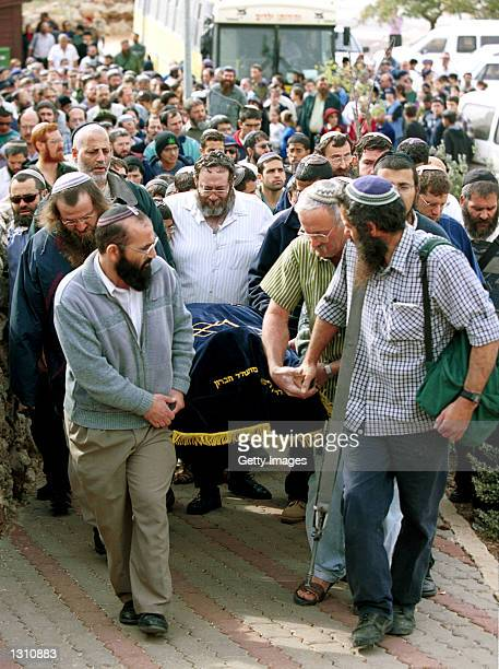Jewish settlers carry the shroudcovered body of Hannah Dudevsky a 39yearold Jewish woman who was killed by Palestinian gunmen in a drivepast shooting...