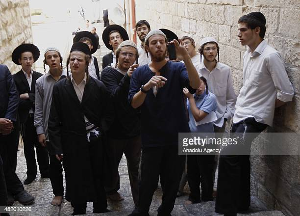 Jewish settlers gather at the AlSilsila Gate to enter the AlAqsa mosque compound in the old city of Jerusalem on July 26 2015 Dozens of Palestinians...