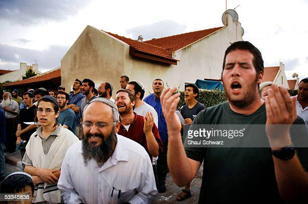 Jewish settlers pray during a mass prayer aimed against the Israeli disengagement plan due to start next week August 9 2005 in Neve Dekalim Gush...