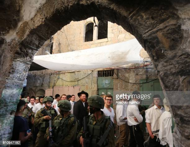 Jewish settlers tour old streets of the city on Israeli soldier's protection in Hebron West Bank on July 08 2017 UNESCO declared in a secret ballot...