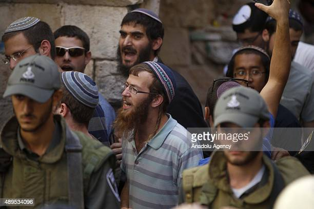 Jewish settlers who get out of Al Aqsa Mosque sing as Palestinians stage a protest against the Israeli violations at Al Aqsa mosque in Jerusalem on...