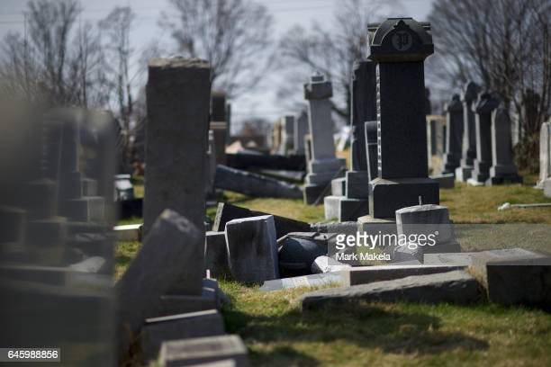 Jewish tombstones lay vandalized at Mount Carmel Cemetery February 27 2017 in Philadelphia Pennsylvania Police are investigating 75100 gravestones...
