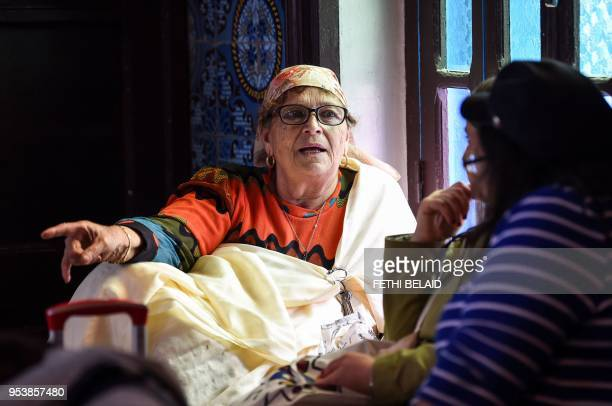 A Jewish Tunisian woman attends service at the Ghriba Synagogue on the Tunisian resort island of Djerba on May 2 2018 during the first day of the...