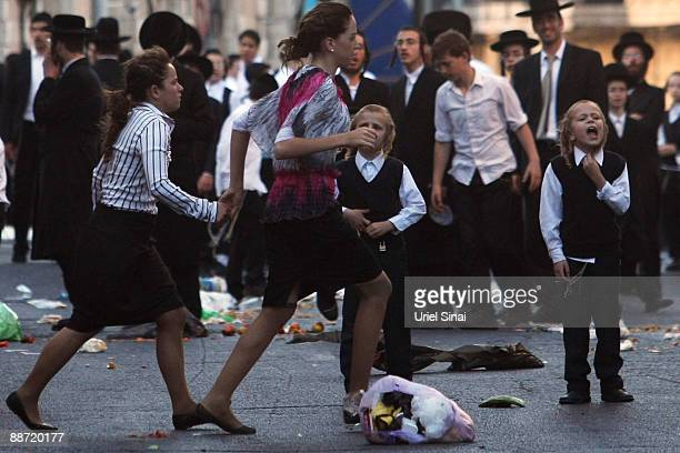 Jewish ultra orthodox girls run during a demonstration on June 27 2009 in Jerusalem Thousands of Orthodox Jews clashed with Israeli police in...