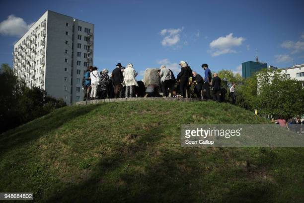Jewish visitors from the United States from Hashomer Hatzair, the international Jewish Socialist-Zionist secular organization, lay flowers and light...