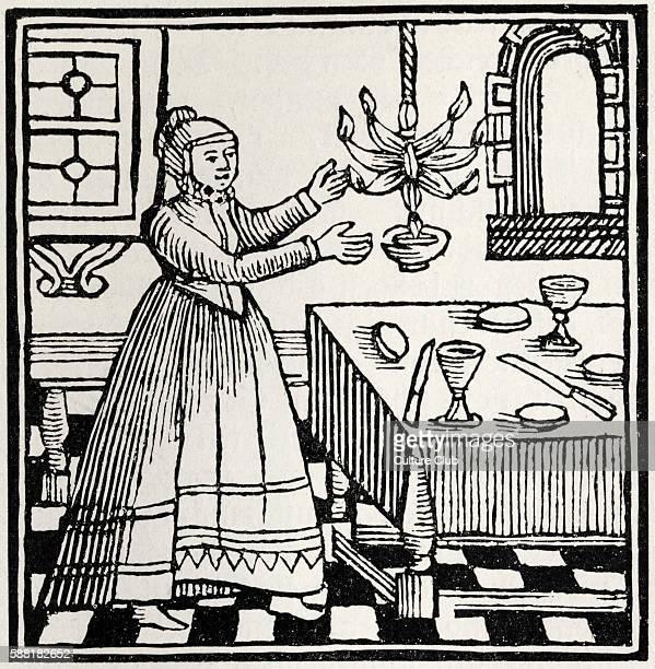 Jewish woman lighting the Sabbath lights Drawing from 1695 Amsterdam Passover Haggadah