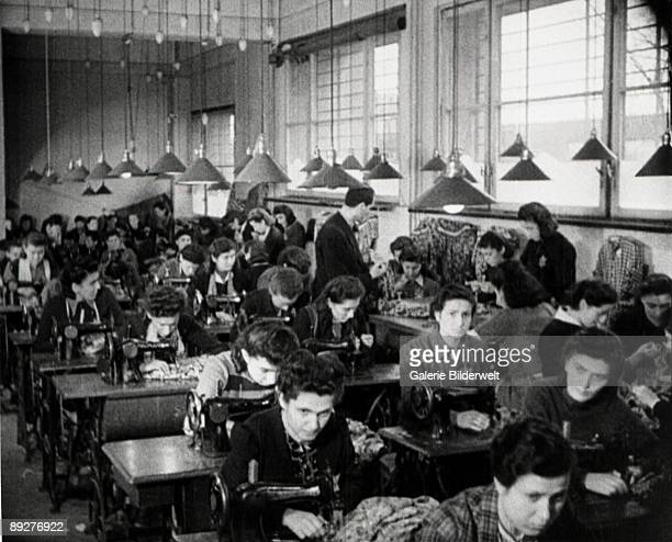 Jewish women are forced to work in a factory in the ghetto in Dabrowa Gornicza Poland 1941
