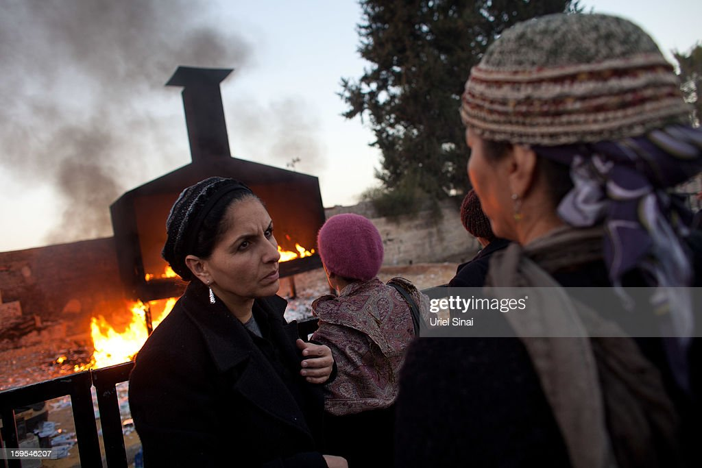 Jewish women pray next to a burning pyre at the grave of Rabbi Yisrael Abuhatzera, known as the sage Baba Sali, on January 15, 2013 in the southern Israeli town of Netivot, Israel. Thousands of Jews, mainly of Moroccan origin, gathered to pray and hold festivities at the tomb of the respected rabbi who was known as a miracle maker by religious Jews.