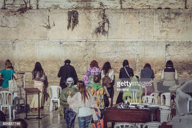 jewish women praying at the western wall of the temple on the temple mount - jewish prayer shawl stock pictures, royalty-free photos & images
