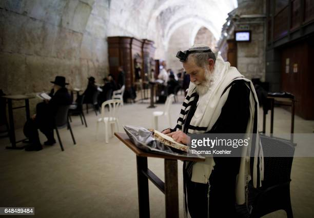 Jews are praying in a hallway next to the Wailing Wall in the historic city center of Jerusalem on February 08, 2017 in Jerusalem, Israel.