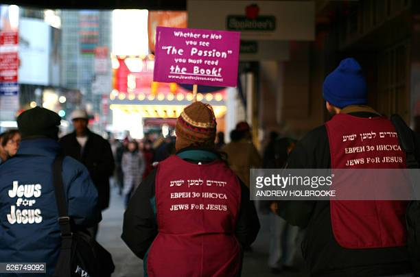 'Jews for Jesus' members promote their views outside a theater where Mel Gibson's 'The Passion of the Christ' on its opening day in New York City's...