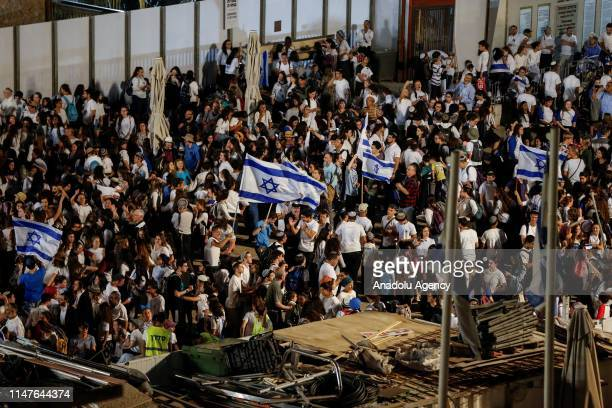 Jews participate in a celebration march as part of the 52nd anniversary of the occupation of East Jerusalem by Israel, at Jerusalems Old City on June...