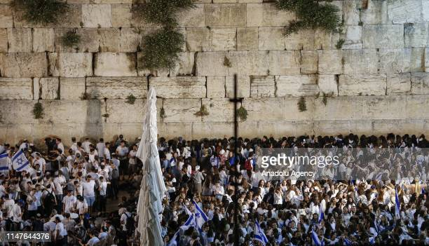 Jews participate in a celebration march as part of the 52nd anniversary of the occupation of East Jerusalem by Israel at Jerusalems Old City on June...