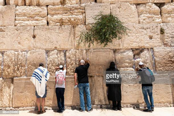 Jews pray at the Western Wall in Jerusalem Israel on June 25 2018 The Western Wall also called the Wailing Wall or Kotel in Hebrew is the most holy...
