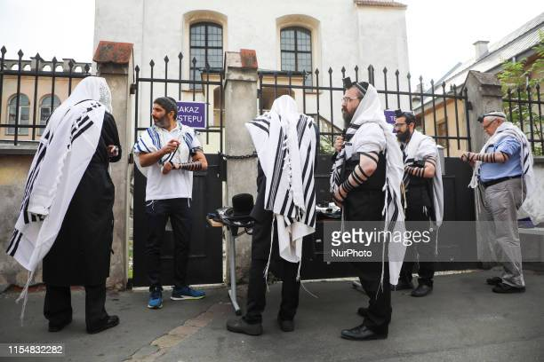 Jews pray outside Izaak Synagogue which was locked for worshippers. Krakow, Poland on 9 July, 2019. Jewish Religious Congregation of Krakow which...