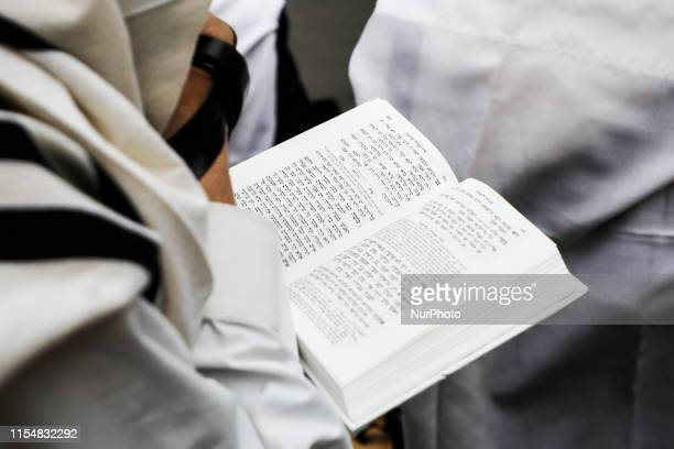 Jews pray outside Izaak Synagogue which was locked for worshippers Krakow Poland on 9 July 2019 Jewish Religious Congregation of Krakow which owns...