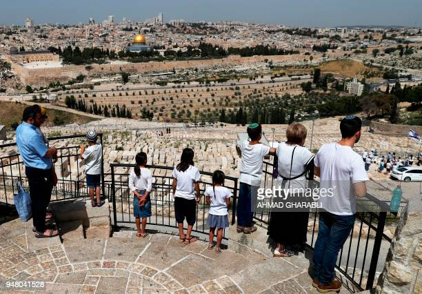TOPSHOT Jews stand on the Mount of Olives looking out over Jerusalem's Old City and the Dome of the Rock as they observe two minutes of silence to...