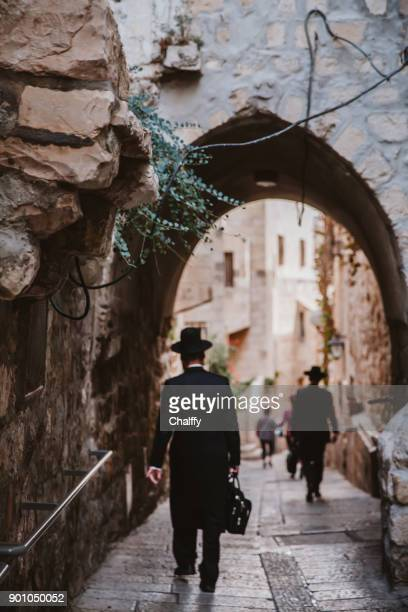 jews walking in jerusalem - jewish prayer shawl stock pictures, royalty-free photos & images