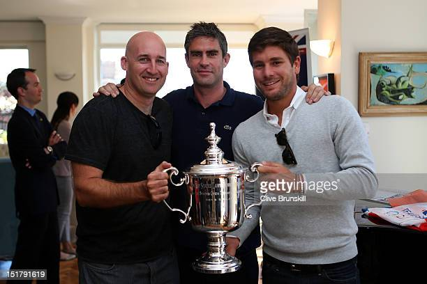 Jez Green Andy Ireland and Daniel Vallverdu pose with the US Open Championship trophy at the British Consulate during Andy Murray of Great Britain's...