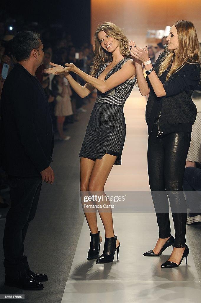 Jeziel Moraes , Gisele Bundchen and Adriana Zucco walk the runway during Colcci show at Sao Paulo Fashion Week Winter 2014 on October 31, 2013 in Sao Paulo, Brazil.