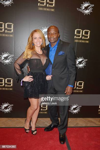 JFran McDuffie and OJ McDuffie attend The Miami Dolphins 'Hall of Fame Celebration' hosting Jason Taylor at Hard Rock Stadium on December 02 2017 in...