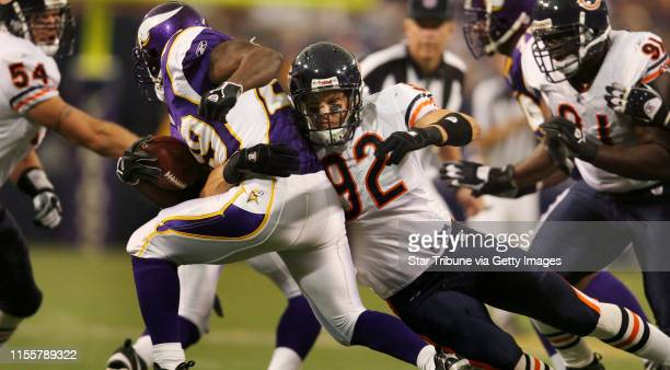 HOLT *jgholt@startribunecom 9/24/2006Vikings running back Chester Taylor is stopped for no gain on this play by Bears linebacker Hunter Hillenmeyer...