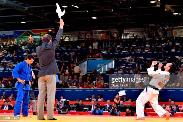Jh Cho of Korea celebrates winning the bronze medal from Sugoi Uriate of Spain in the 66kgs category after extra time at ExCeL, on July 29, 2012 in...