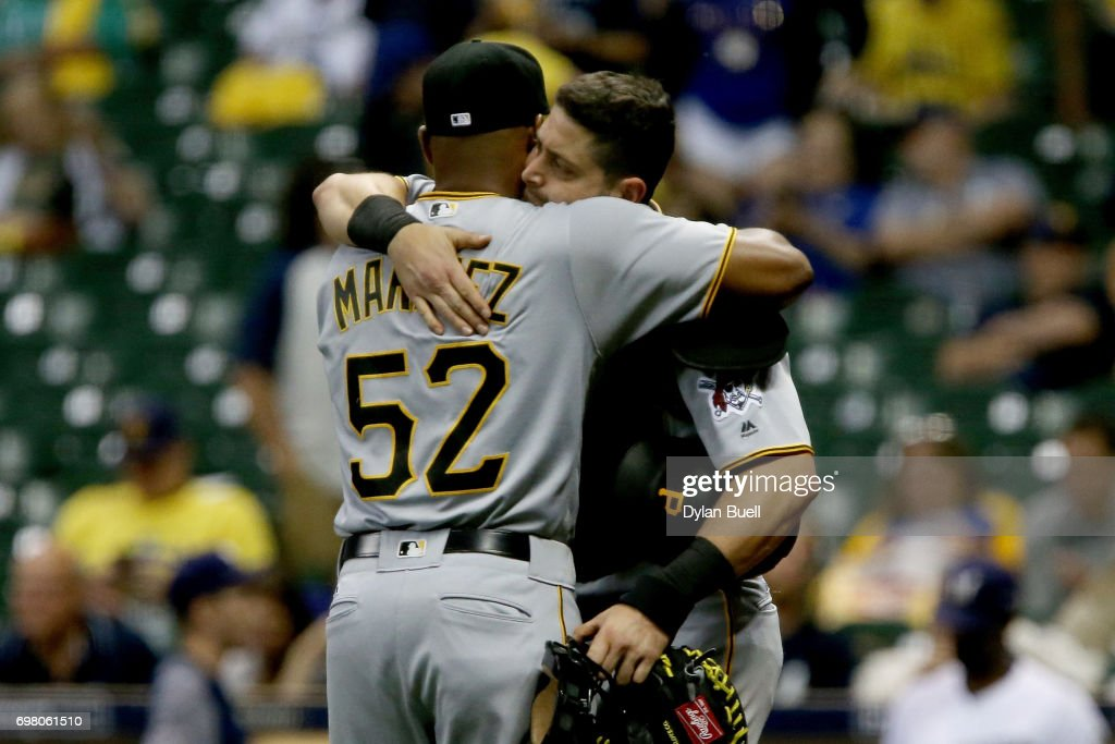 Jhan Marinez #52 and Francisco Cervelli #29 of the Pittsburgh Pirates celebrate after beating the Milwaukee Brewers 8-1 at Miller Park on June 19, 2017 in Milwaukee, Wisconsin.
