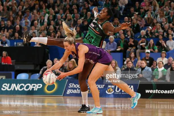 Romelda Aiken of the Firebirds catches the ball against Stacey Francis of the Fever during the round 12 Super Netball match between the Fever and the...