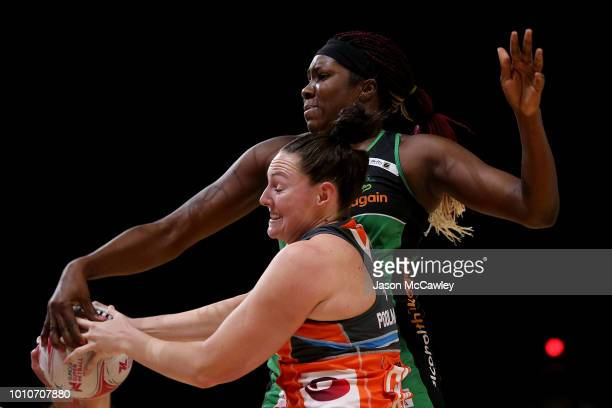 Jhaniele Fowler of the Fever and Sam Poolman of the Giants compete for the ball during the round 14 Super Netball match between the Giants and the...