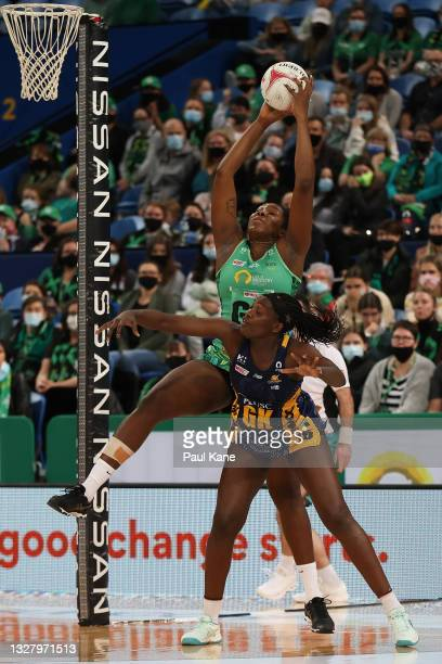 Jhaniele Fowler of the Fever catches a pass against Phumza Maweni of the Lightning during the round 10 Super Netball match between the West Coast...