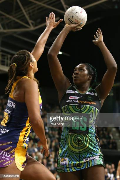 Jhaniele Fowler of the Fever puts a shot up during the round 10 Super Netball match between the Fever and the Lightning at HBF Stadium on July 7 2018...