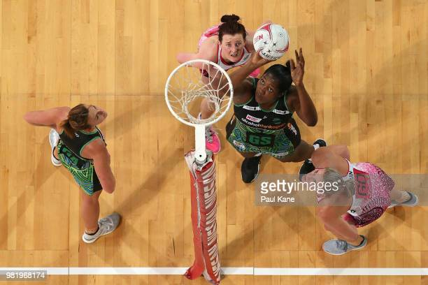 Jhaniele Fowler of the Fever shoots the ball during the round eight Super Netball match between the Fever and the Thunderbirds at Perth Arena on June...