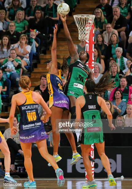 Jhaniele Fowler of the West Coast Fever reaches over the top of Geva Mentor of the Sunshine Coast Lightning during the Super Netball Grand Final...