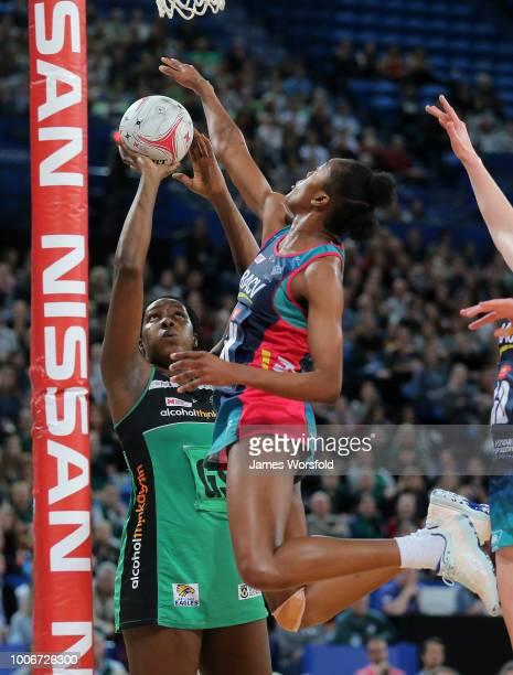 Jhaniele Fowler of the West Coast Fever tries to take a shot while under pressure from a leaping KadieAnn Dehaney of the Melbourne Vixens during the...