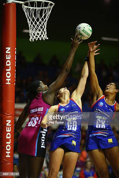 Jhaniele Fowler-Reid of the Steel and Julie Corletto and Temalisi Fakahokotau of the Mystics compete for posession during the round 10 ANZ...
