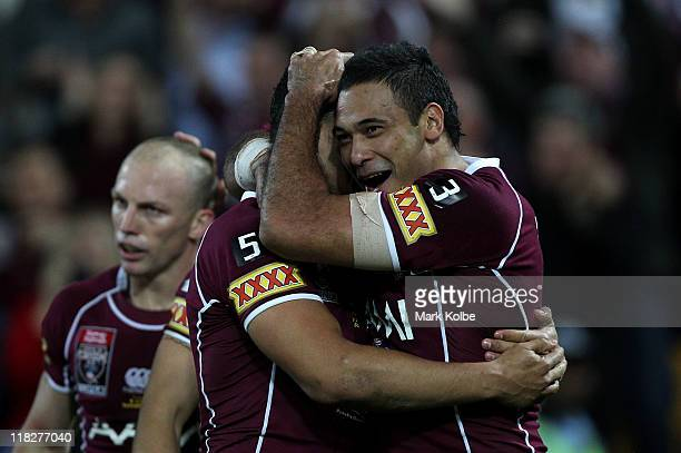 Jharal Yow Yeh and Justin Hodges of the Maroons celebrate after a try during game three of the ARL State of Origin series between the Queensland...