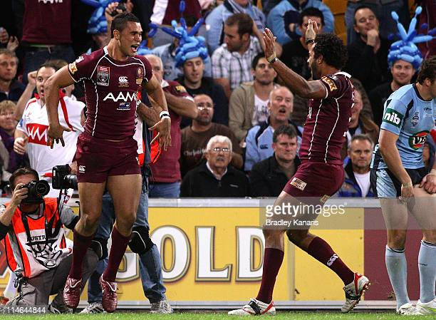 Jharal Yow Yeh of the Maroons celebrates after scoring a try during game one of the ARL State of Origin series between the Queensland Maroons and the...
