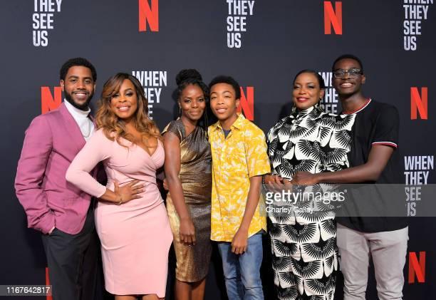 Jharrel Jerome Niecy Nash Marsha Stephanie Blake Asante Blackk Aunjanue Ellis and Ethan Herisse attend Netflix's When They See Us Screening Reception...