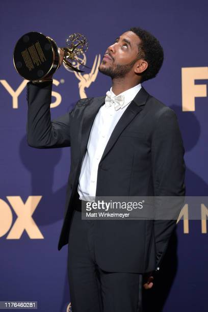 Jharrel Jerome poses with award for Outstanding Lead Actor in a Limited Series or Movie in the press room during the 71st Emmy Awards at Microsoft...