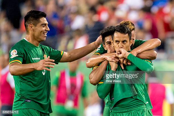 Jhasmani Campos of Bolivia celebrates with teammates after scoring the first goal of his team during a group D match between Chile and Bolivia at...